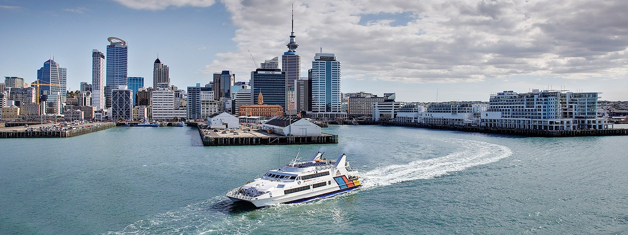 A Fullers Ferry comes out of the Downtown Ferry Terminal on Auckland's waterfront