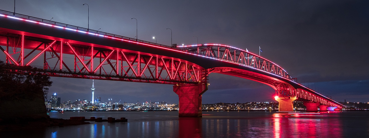 Auckland's Harbour Bridge shines as it is lit up by Vector Lights