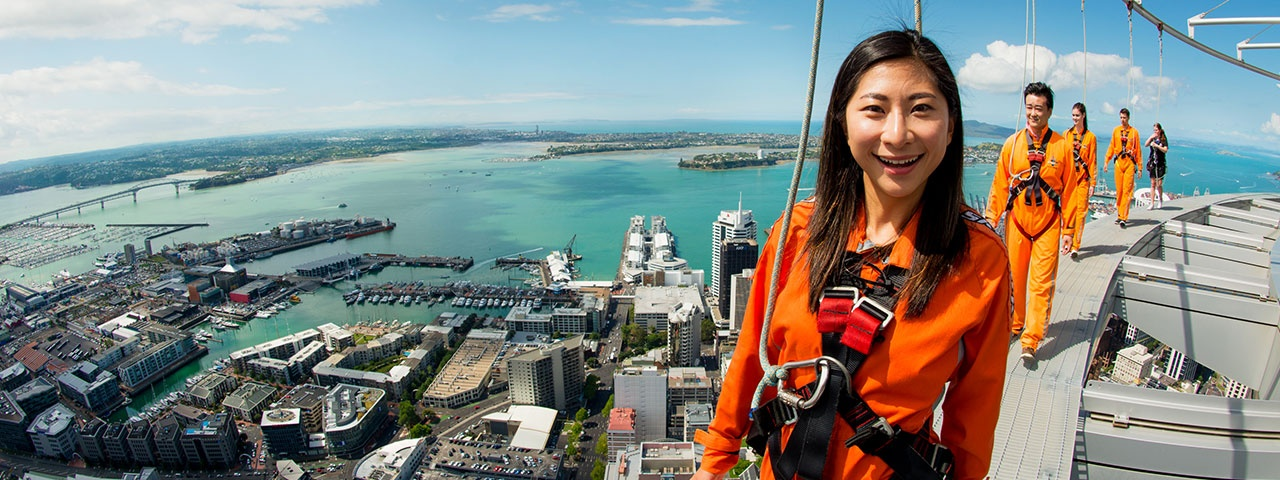 A lady and her friends enjoying an amazing view of Auckland from the SkyWalk