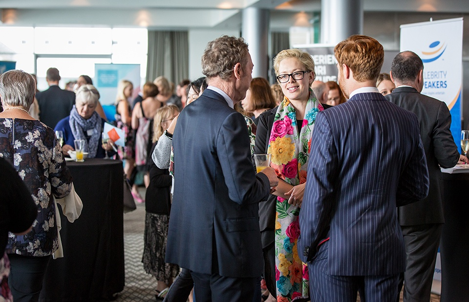 Group of three networking at an event