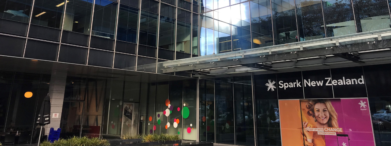 Image shows entrance to Spark building in Auckland