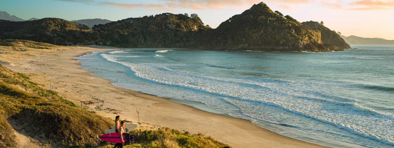 Surfers at Medlands Beach, Great Barrier Island