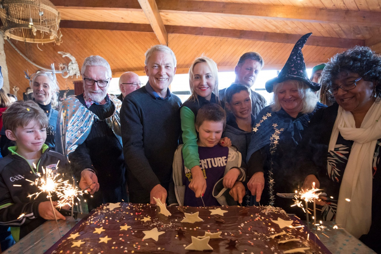 Auckland Mayor Phill Goff cuts a cake to celebrate the launch of Great Barrier Island's dark sky sanctuary