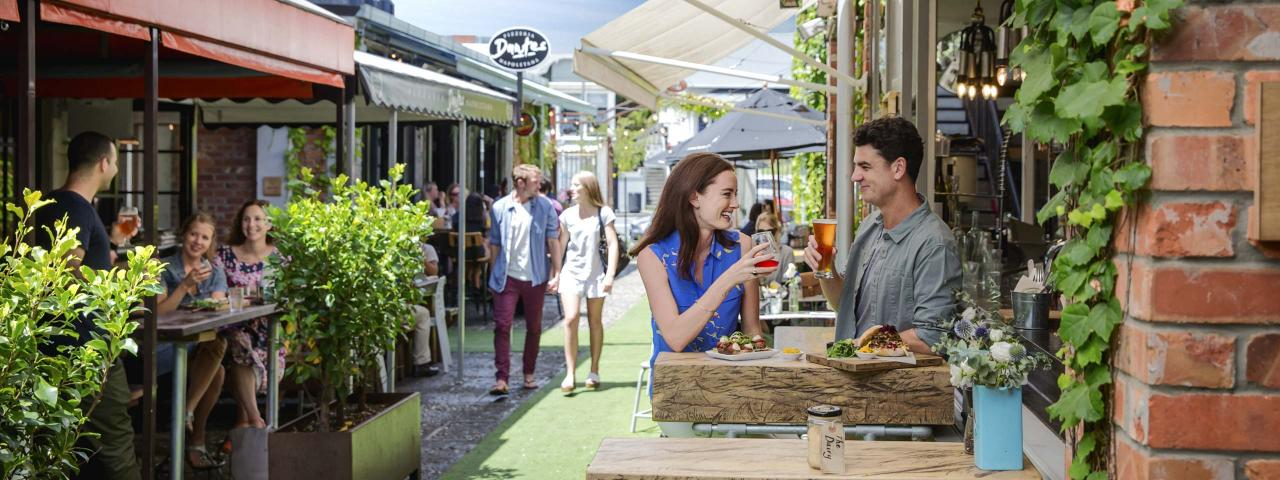 Couple making a toast outdoors at Ponsonby Central (credit: Milles Holden)