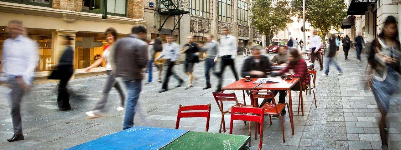 Crowds walking past outdoor table in city lane (credit: Auckland Council)