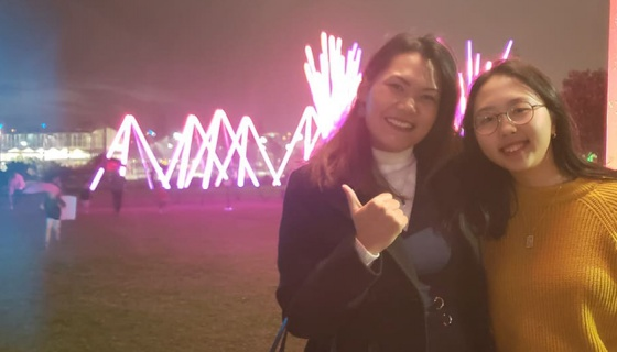 Jhe Valenzuela and Sonia Min in front of a light display at Stellar - Festival of Lights, part of Elemental AKL 2019